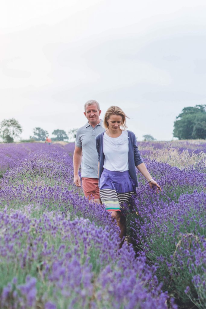 couple walking through lavender fields wedding photography